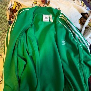 green adidas zip up